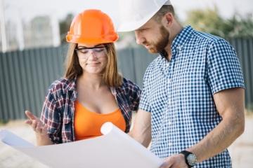 Builder Showing Blueprint to Colleague